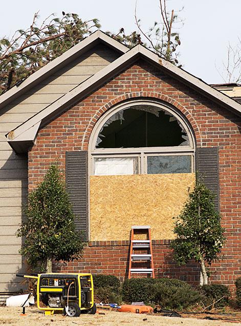Board Up Service - Window in Brick House